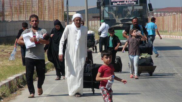 Bayram ziyaretine giden 49 bin Suriyeli döndü - Sputnik Türkiye