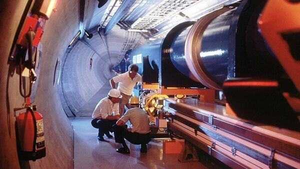 An undated picture released by the CERN, European Council for Nuclear Research, shows a mock-up of the Large Hadron Collidor or LHC atom-smasher which is to be built in an existing 27 kilometers tunnel near Geneva - Sputnik Türkiye