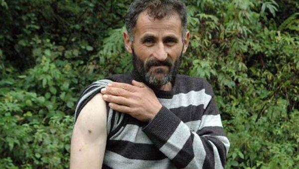 Kendisine saldıran ayıya yumruk attı, kurtuldu - Sputnik Türkiye