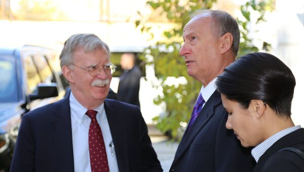 Russian Security Council Secretary Nikolai Patrushev (second from right) and US National Security Adviser John Bolton during a meeting in Moscow. - Sputnik Türkiye