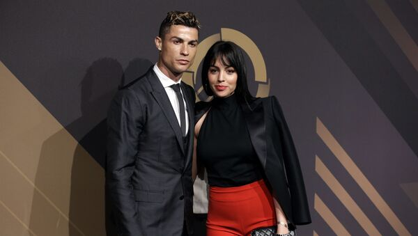 In this March 19, 2018 file photo, Real Madrid player Cristiano Ronaldo and his girlfriend Georgina Rodriguez pose for photos as they arrive for the Portuguese soccer federation awards ceremony in Lisbon - Sputnik Türkiye