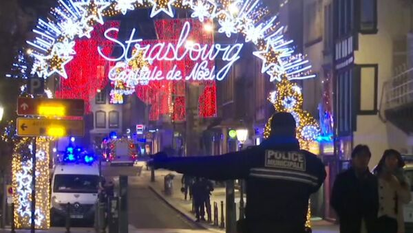 In this image made from video, emergency services arrive on the scene of a Christmas market in Strasbourg, France, Tuesday, Dec. 11, 2018 - Sputnik Türkiye