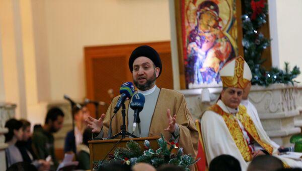 Bağdat'taki Aziz George Keldani Katolik Kilisesi'ndeki Noel ayinine, Irak İslami Yüksek Konseyi'nden ayrılıp Hikmet Hareketi'ni kuran Şii siyasetçi Ammar el Hekim de katıldı. - Sputnik Türkiye