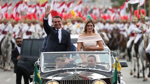 Brazil's new President Jair Bolsonaro waves as he drives past before his swear-in ceremony - Sputnik Türkiye