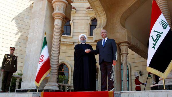 İran Cumhurbaşkanı Hasan Ruhani, resmi ziyaret kapsamında ilk kez gittiği Irak'ın başkenti Bağdat'ta Cumhurbaşkanı Berhem Salih tarafından karşılandı. - Sputnik Türkiye