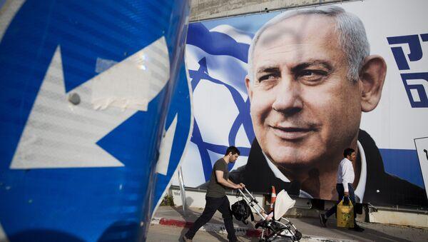 A man walks by an election campaign billboard showing Israel's Prime Minister Benjamin Netanyahu, the Likud party leader, in Tel Aviv, Israel, Sunday, April 7, 2019 - Sputnik Türkiye