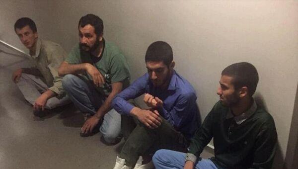 AA'da yer alan habere göre, MİT'in Şengal'de PKK ve KCK hedeflerine yönelik operasyonunda yakalanan 4 PKK üyesi, Irak'tan Türkiye'ye götürüldü. - Sputnik Türkiye