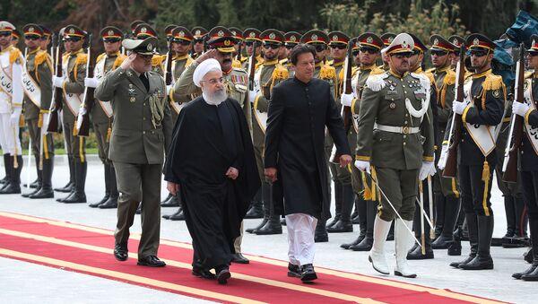 İran Cumhurbaşkanı Hasan Ruhani ve Pakistan Başbakanı İmran Han - Sputnik Türkiye