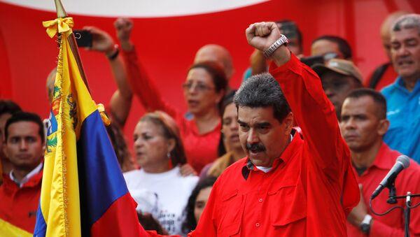 Venezüella Devlet Başkanı Nicolas Maduro, başkent Caracas kent merkezi Devlet Başkanlığı Sarayı Miraflores'in karşısındaki Sucre Bulvarında, 1 Mayıs Emek ve Dayanışma Günü kapsamında düzenlenen etkinliktekonuştu. - Sputnik Türkiye