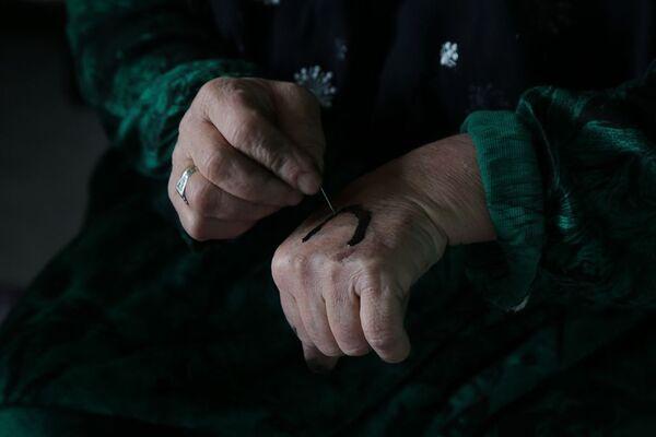 İnsan bedenine işlenen yarım asırlık gelenek: Deq - Sputnik Türkiye