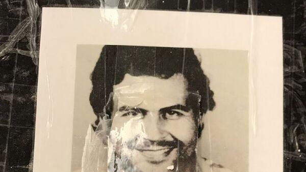Kokain ambalajlarında Kolombiyalı uyuşturucu baronu Pablo Escobar'ın fotoğraflarının yer alması dikkati çekti. - Sputnik Türkiye