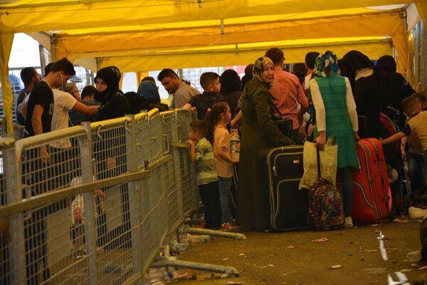 Suriyelilerin bayram için ülkelerine dönüşü sürüyor - Sputnik Türkiye