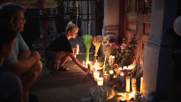 ABD'de Dayton kentinin Oregon bölgesindeki Ned Peppers isimli bir barın önünde gerçekleşen saldırı anıldı. - Sputnik Türkiye