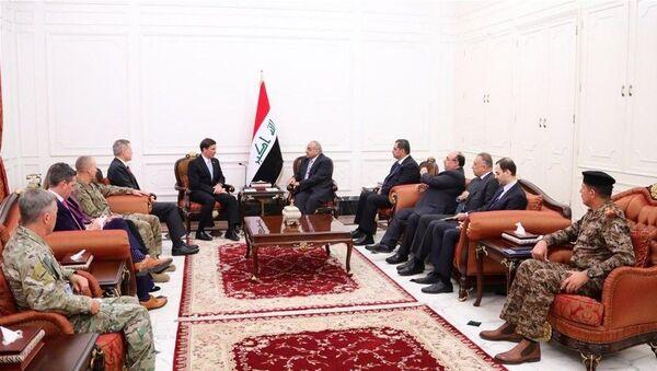 Irak'ın başkenti Bağdat'taki temaslarını sürdüren ABD Savunma Bakanı Mark Esper, Irak Başbakanı Adil Abdülmehdi ile bir araya geldi. - Sputnik Türkiye