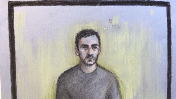 İngiltere'de Essex'de bir TIR'ın ardında 39 kişinin cansız bedeninin bulunmasından sorumlu tutulan sürücü Maurice 'Mo' Robinson ilk kez mahkemeye çıktı.  - Sputnik Türkiye
