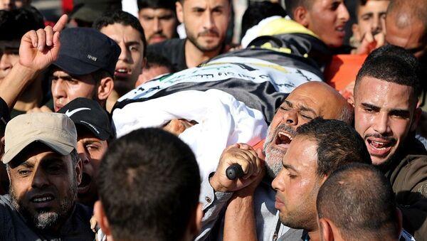 'İslami Cihad'ın askeri kanadı 'Kudüs Seriyyeleri'nin önde gelen komutanlarından ve İsrail'in saldırısında öldürülen Beha Ebu'l Ata'nın cenazesi  - Sputnik Türkiye
