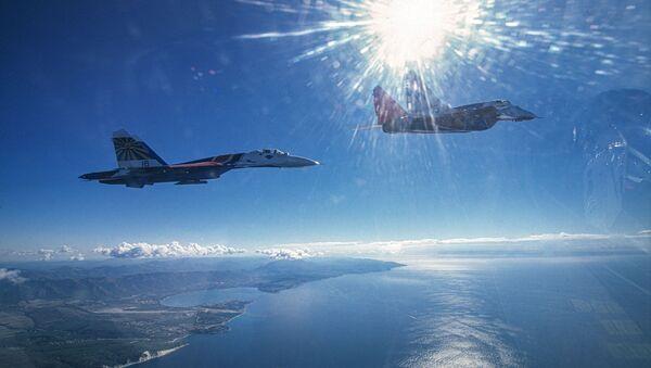Rus Hava Kuvvetleri uçaklarının uçuş sırasında çekilen fotoğrafları - Sputnik Türkiye