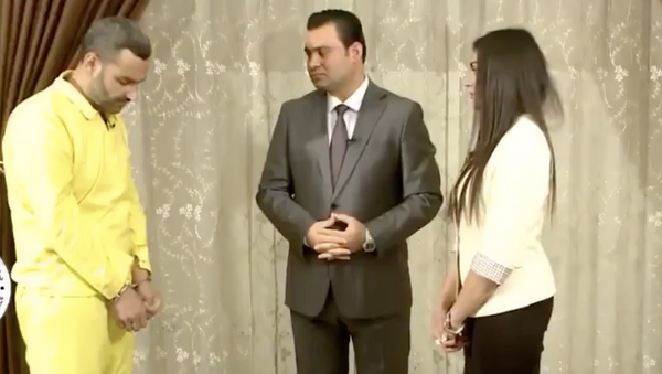 Ezidi kadın Aşvak Hacı Hamid'in kendisine tecavüz eden IŞİD'li Ebu Humam'a hesap sorduğu video,Irak Medya Ağı kanalında yayımlandı. - Sputnik Türkiye
