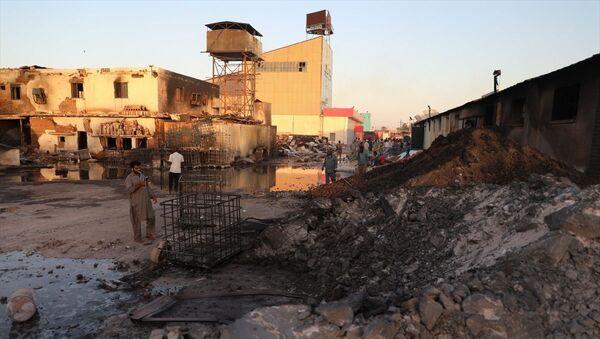 Sudan'ın Hartum Eyaleti'ne bağlı Kuzey Hartum kentindeki bir seramik fabrikasında meydana gelen patlamada 23 kişinin hayatını kaybettiği 130 kişinin de yaralandığı belirtildi - Sputnik Türkiye