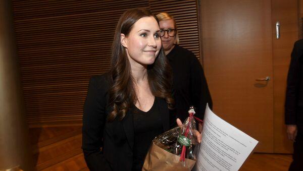 Finlandiya'nın Ulaştırma Bakanı Sanna Marin, Sosyal Demokrat Parti'nin lideri olarak seçilerek 'dünyanın en genç başbakanı' unvanına sahip oldu. - Sputnik Türkiye