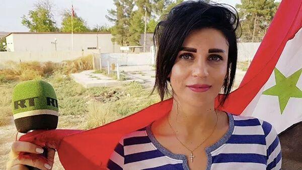 Russia Today (RT) Arabic muhabiri Vafa Shabruni - Sputnik Türkiye