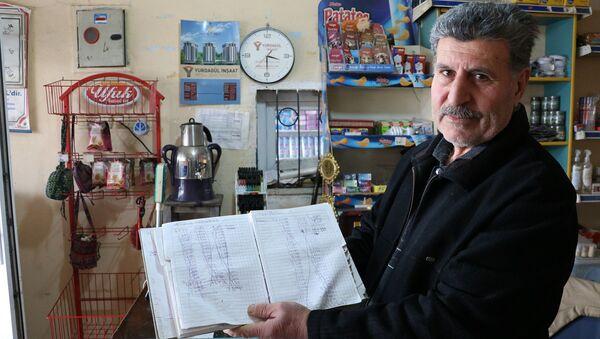 Kahramanmaraş'ta iki kişi veresiye defterindeki 5 bin liralık borcu ödedi - Sputnik Türkiye