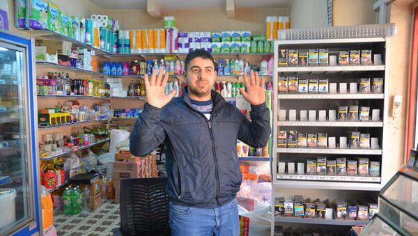 Beş kişinin gasp ettiği market sahibi Hasan Özkaya - Sputnik Türkiye