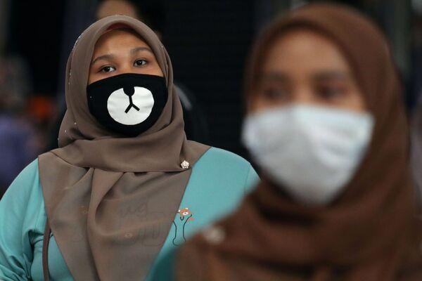 Dünya genelinde koronovirüse karşı takılan maskeler - Sputnik Türkiye