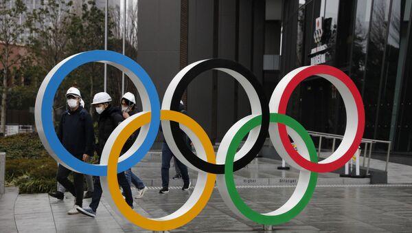 2020 Yaz Olimpiyatları'na ev sahipliği yapmaya hazırlanan Japonya'da hazırlıklar koronavirüs gölgesinde gerçekleşiyor. - Sputnik Türkiye