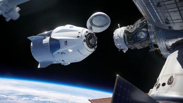 SpaceX'in Falcon 9 roketi ile birlikteuzaya fırlattığı NASA'nınCrew Dragonuzay kapsülü, Uluslararası Uzay İstasyonu'na bağlandı - Sputnik Türkiye