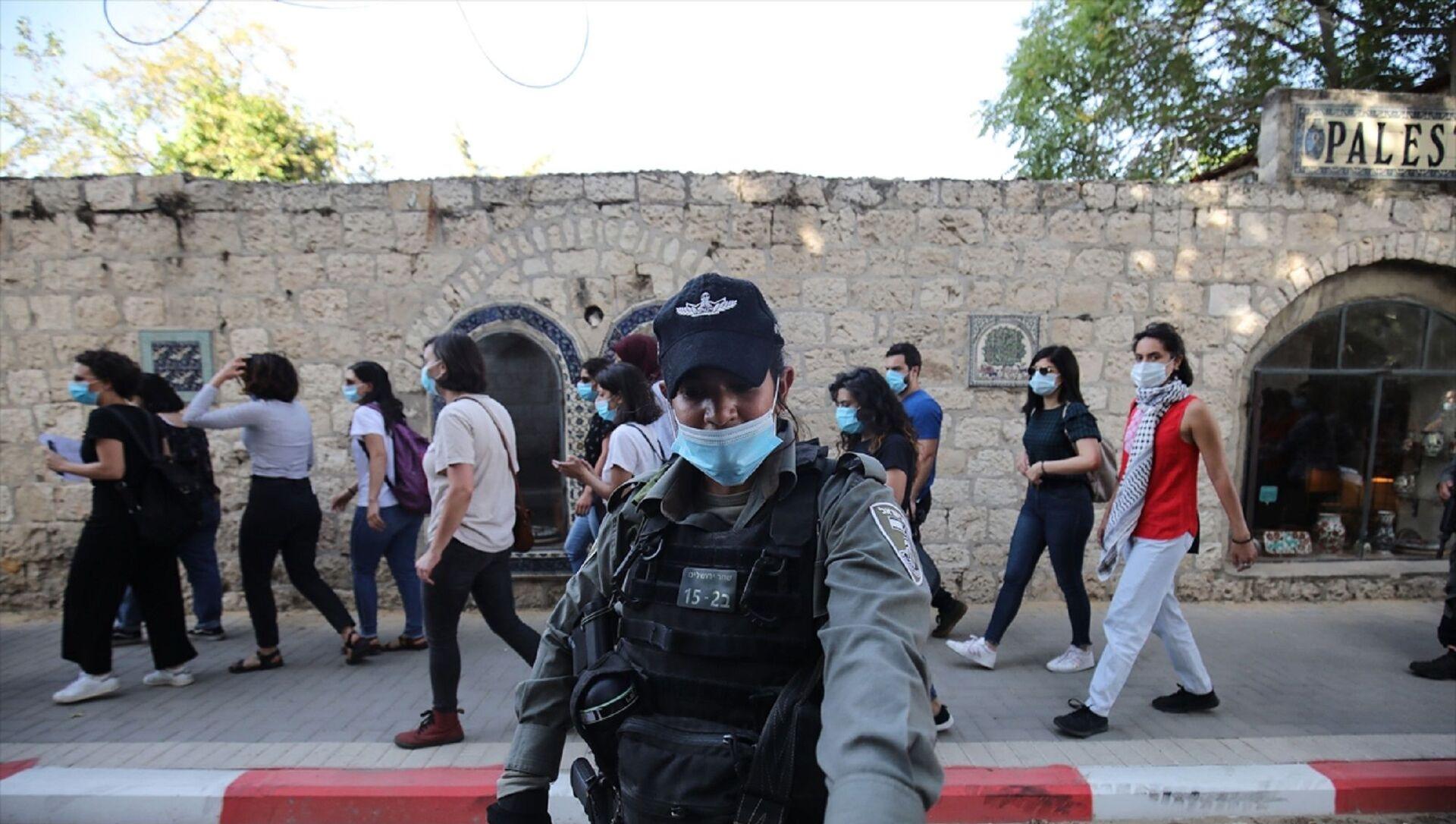İsrail polisi, Doğu Kudüs'te otizmli İyad Hallak'ın öldürülmesine tepki amacıyla düzenlenen gösteriye müdahale ederek 3 Filistinli kadını gözaltına aldı. - Sputnik Türkiye, 1920, 17.04.2021